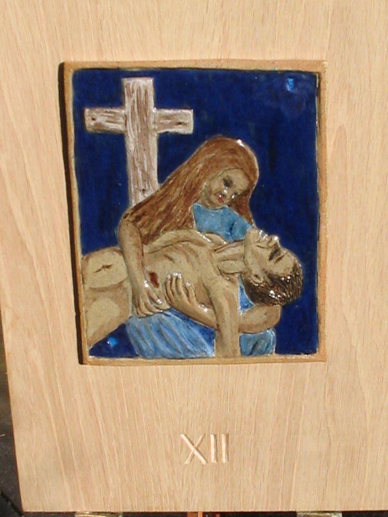 12. Jesus' body is taken down from the cross.